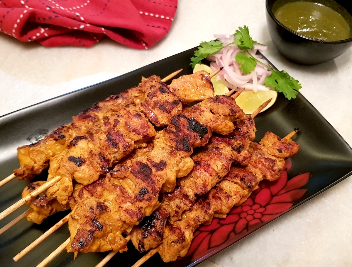 succulent chicken thighs marinated in yoghurt and spices and grilled
