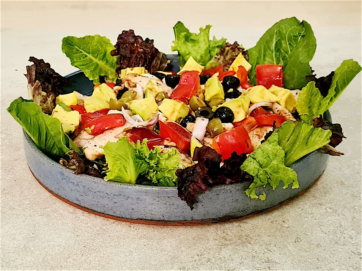 salad with lettuce vegetables and grilled chicken